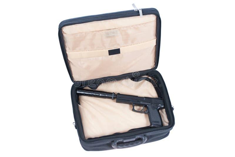 Mördarefall - handeldvapen med ljuddämparen royaltyfria foton