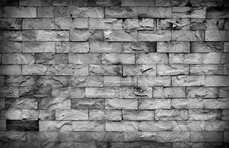 Mörk bakgrund för sandstenväggtextur Detalj av textur f?r sandstenv?gg Härlig svart textur för sandstenvägg royaltyfria foton