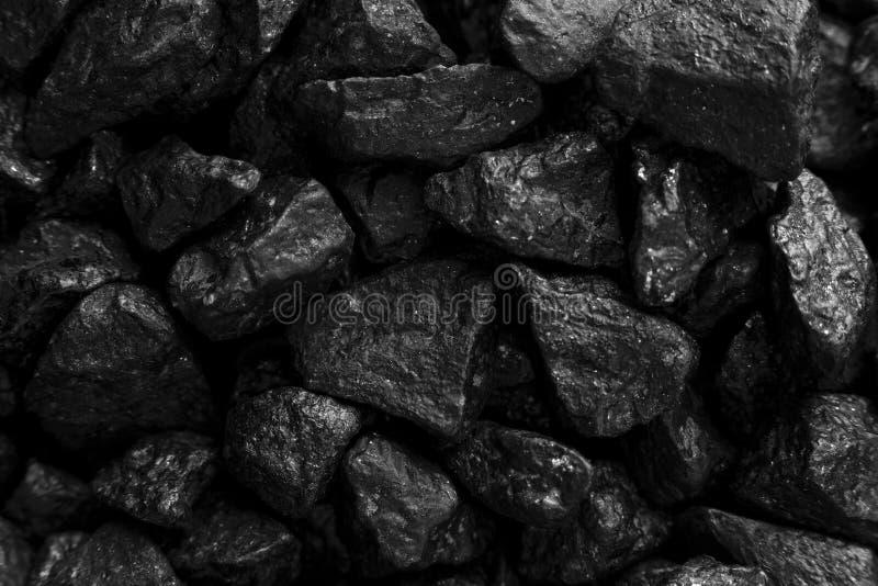 Mörk bakgrund för svart kolcloseup fotografering för bildbyråer
