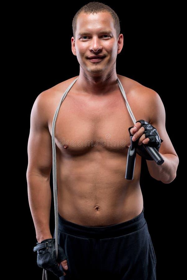 Mörk bild av en ung idrottsman nen med ett rep fotografering för bildbyråer