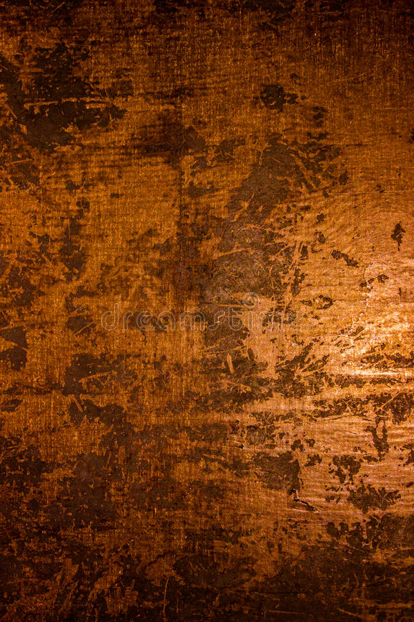 Mörk gammal läskig rostig grov guld- och koppartextur för metallyttersida/bakgrund för allhelgonaafton eller spökat hus spelar ba royaltyfri foto