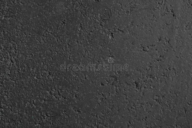 Mörk grå asfaltabstrakt begrepptextur arkivfoto