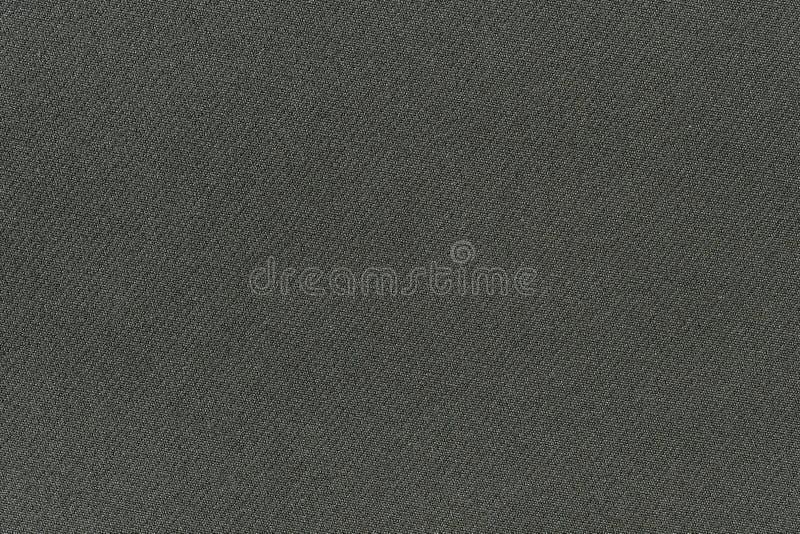 Mörk grå tygbakgrundstextur Detalj av linnetextilmaterial royaltyfri foto