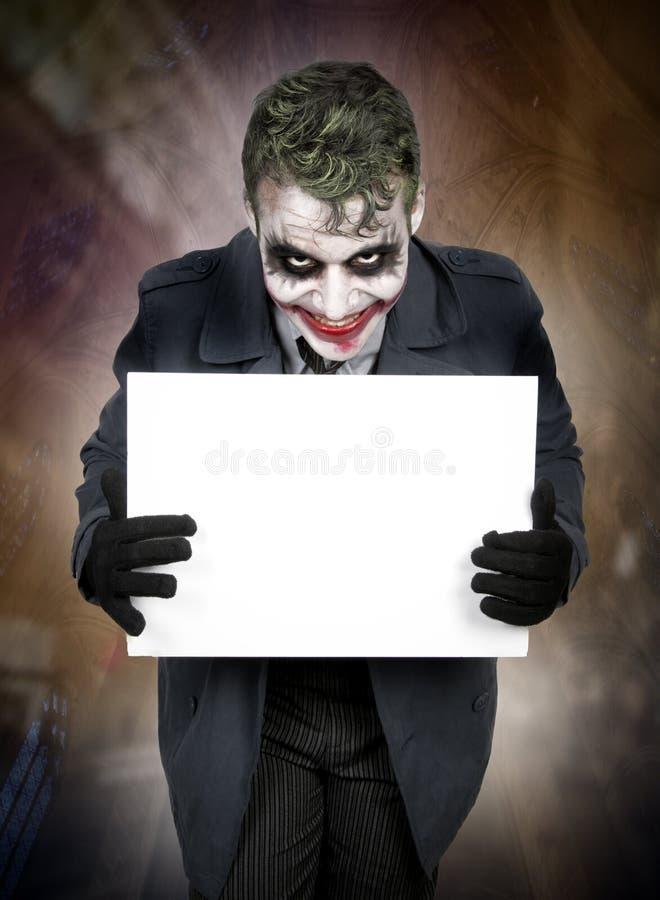 Mörk kuslig jokerframsida arkivfoto