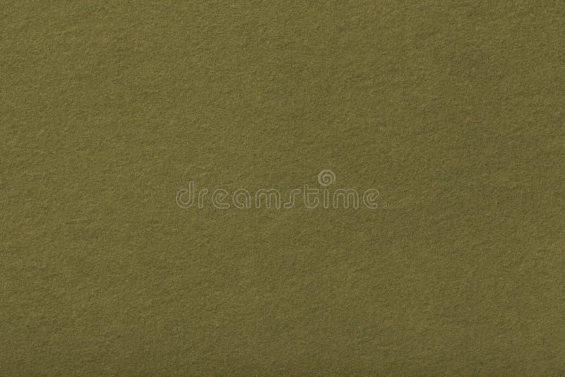 Mörk olivgrön matt mockaskinntygcloseup Sammettextur av filt arkivbilder