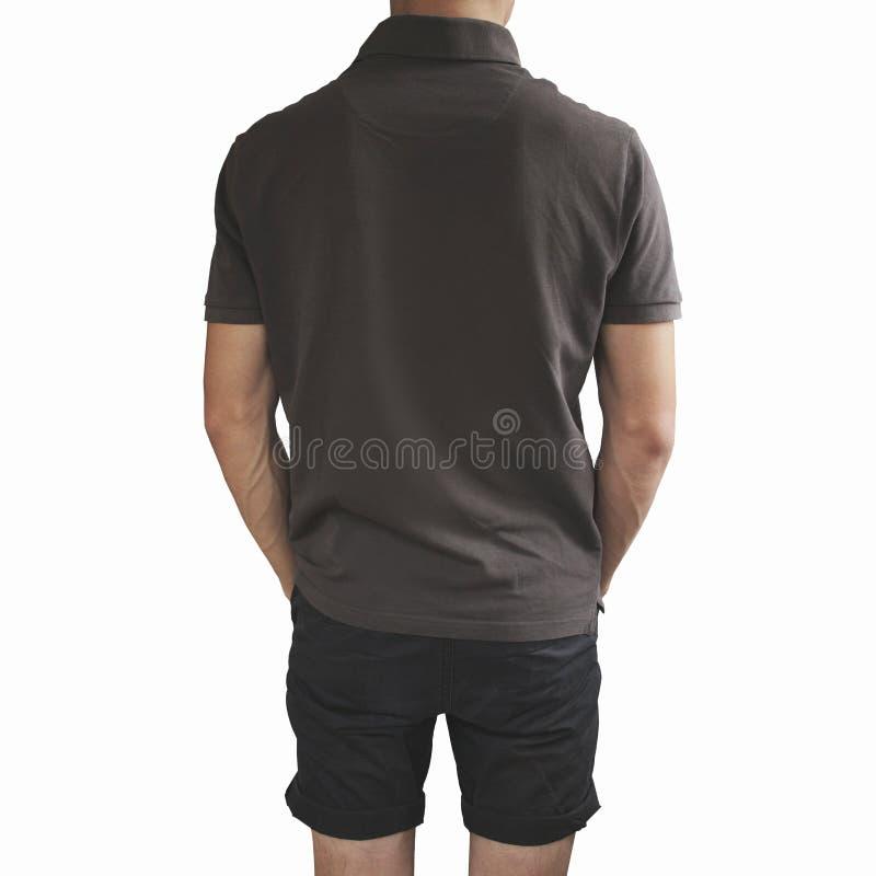 Mörk skjorta för grå färger t och svartkortslutningar på en mall för ung man på gr arkivbild