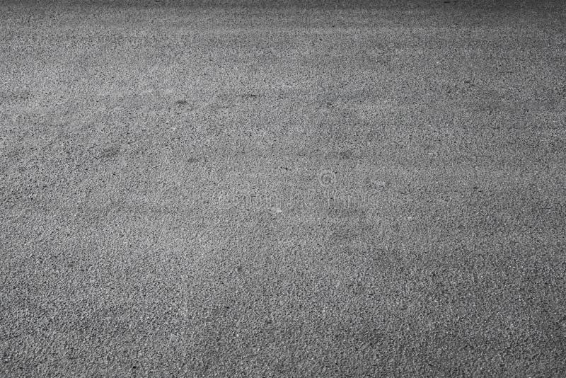 Mörk stads- textur för bakgrund för asfaltväg arkivbilder