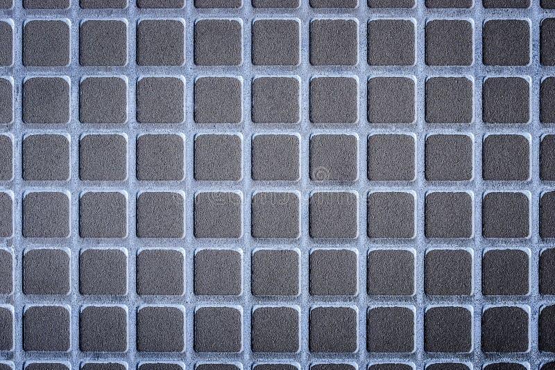 Mörk stenbakgrund för lättnad arkivbild