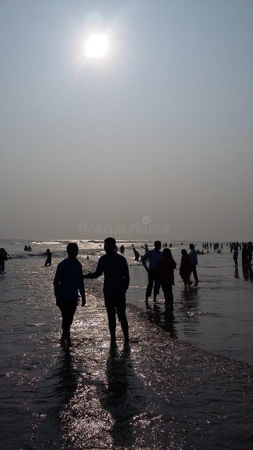 Mörk strand fotografering för bildbyråer