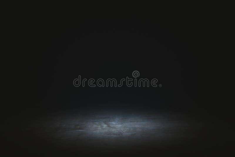 Mörk tapet med strålkastaren arkivfoto