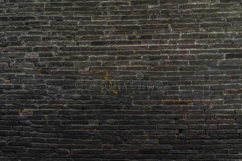 Mörk tegelstenvägg royaltyfri fotografi