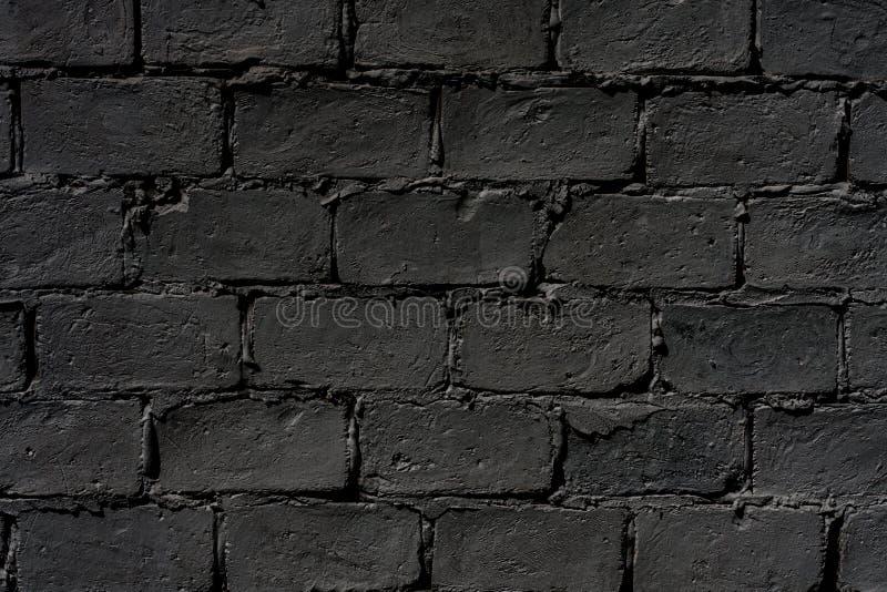 Mörk tegelstenvägg royaltyfria bilder