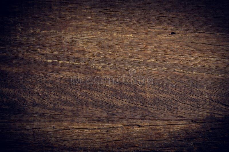 Mörk wood bakgrund, yttersida för träbrädebusekorn royaltyfria bilder