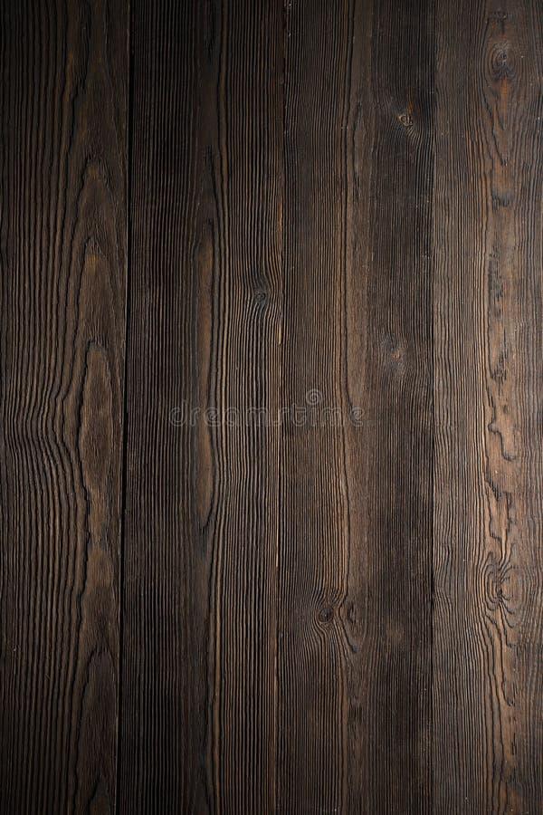 Mörk wood bakgrundsbruntfärg royaltyfri foto