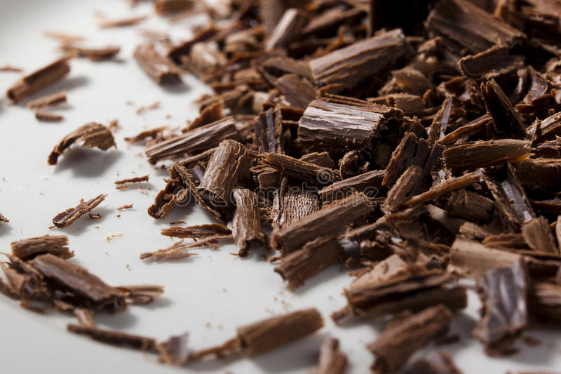 Mörka chokladshavings arkivfoto