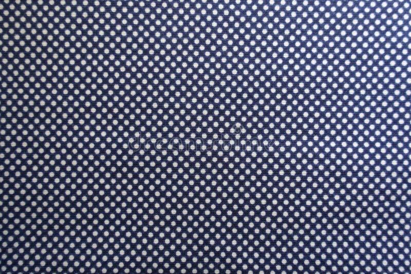 Mörker - blått tyg med prickar från över arkivfoton