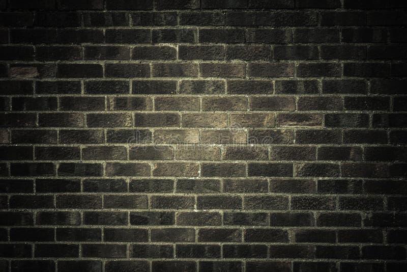 Mörker - grå tegelstenvägg som textur eller bakgrund royaltyfria foton