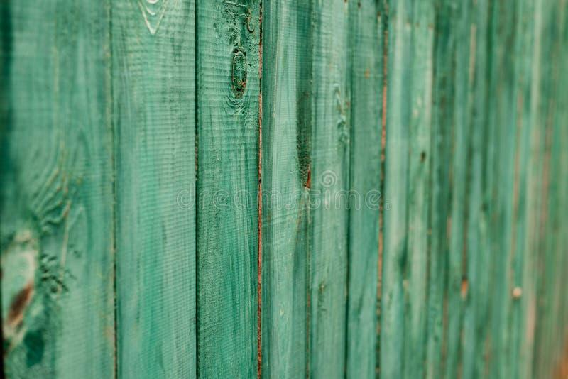 Mörker - gröna gamla träbräden Bakgrunder och målat texturstaket Bekläda beskådar Tilldra en härlig tappningbakgrund arkivbilder