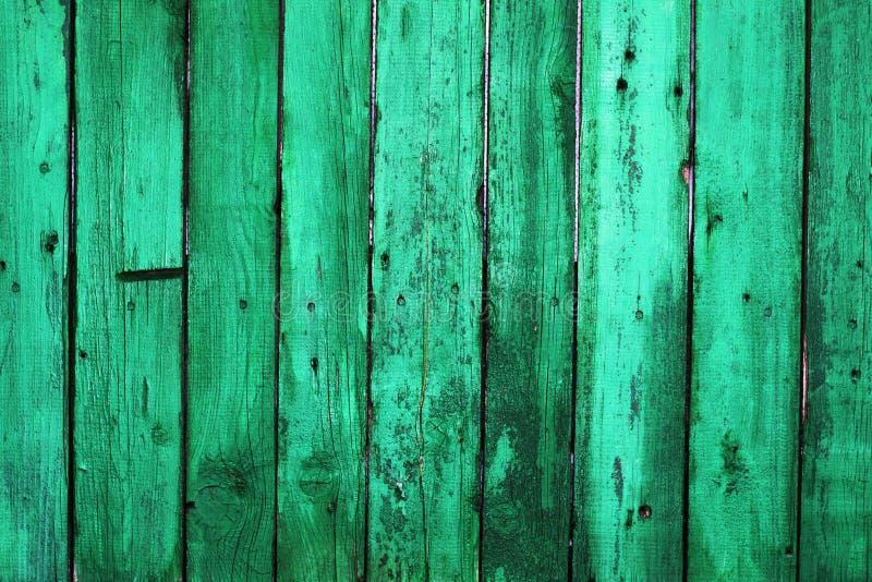 Mörker - gröna gamla träbräden Bakgrunder och texturstaketpai royaltyfri fotografi