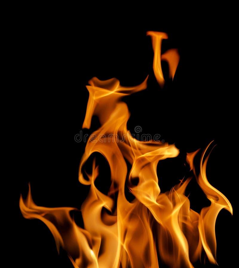 Mörker - orange flammadans på svart arkivbild