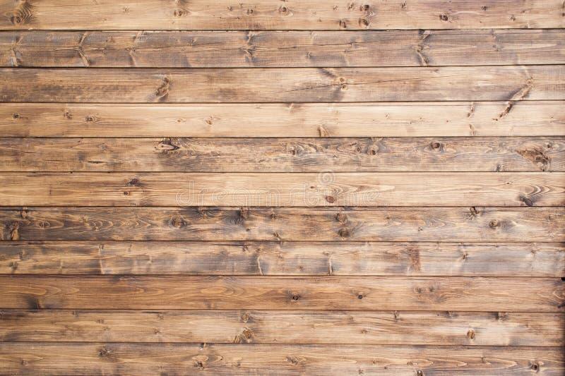 Mörker runda ovala Shape, Wood panelbakgrund, naturlig brun färg, staplar horisontal för att visa korntextur som väggen arkivfoton