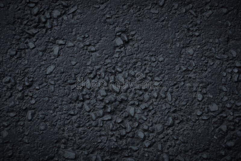 mörkret - grå asfalttexturbakgrund vaggar arkivbild