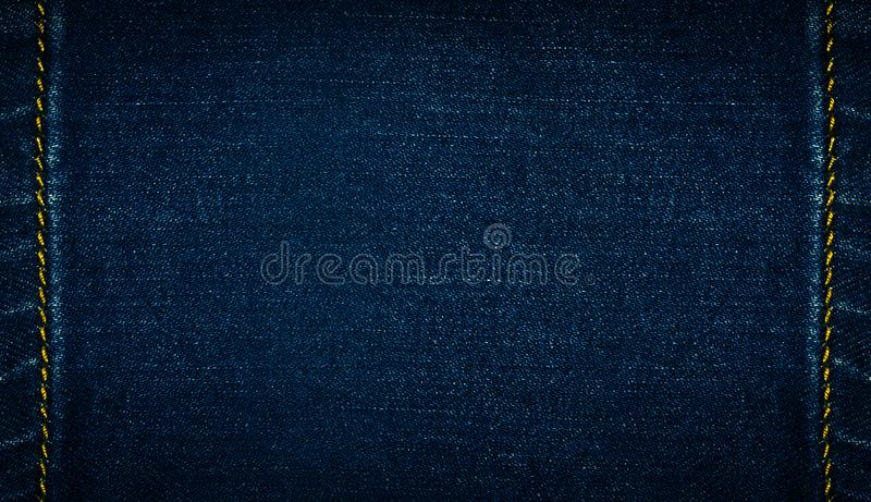 Mörkt - blå grov bomullstvilljeans, bakgrund royaltyfri fotografi