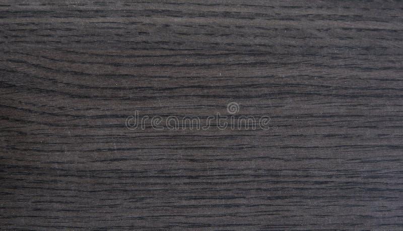 Mörkt exotiskt fejkar wood trycktextur fotografering för bildbyråer