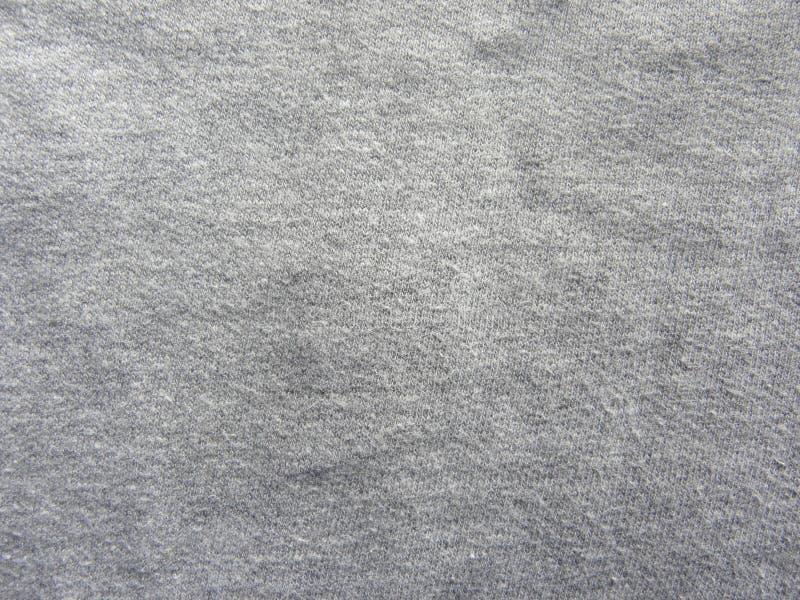 Mörkt - för bomullstyg för grå färg mjuk bakgrund för textur royaltyfri bild