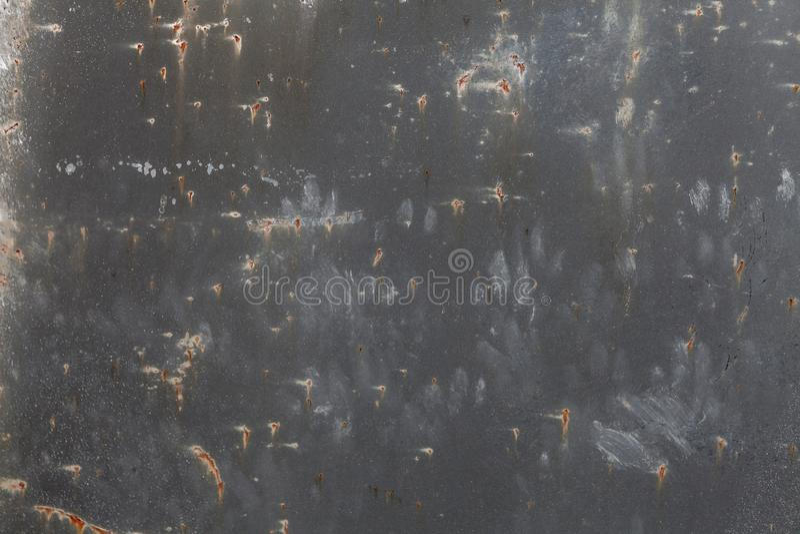 Mörkt - grå rostig metalltexturbakgrund Tappningeffekt royaltyfri fotografi