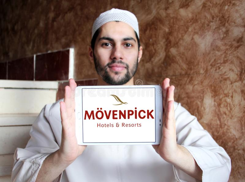 Mövenpick Hotels and Resorts logo. Logo of Mövenpick Hotels & Resorts on samsung tablet holded by arab muslim man. Mövenpick is a hotel management royalty free stock photography