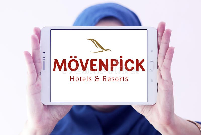 Mövenpick Hotels and Resorts logo. Logo of Mövenpick Hotels & Resorts on samsung tablet holded by arab muslim woman. Mövenpick is a hotel management stock image