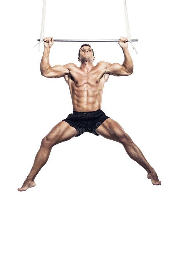Músculo que faz elevações fotos de stock royalty free