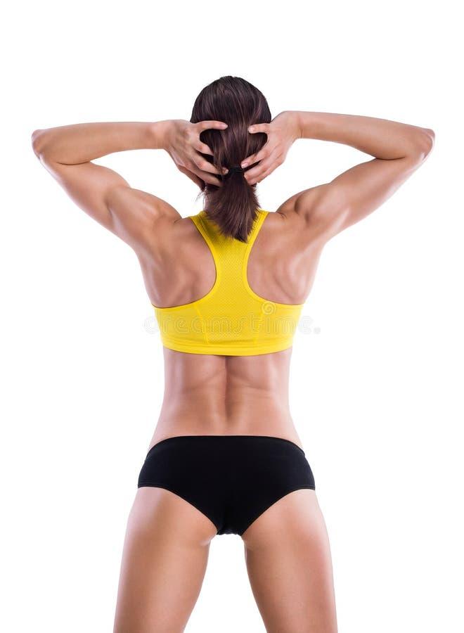 Músculos en un cuerpo de la mujer hermosa de la aptitud foto de archivo