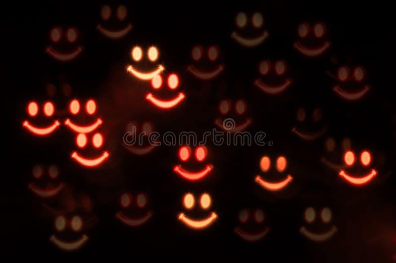 Música da noite Caras assustadores de sorriso do fantasma na obscuridade Conceito de Halloween fotografia de stock