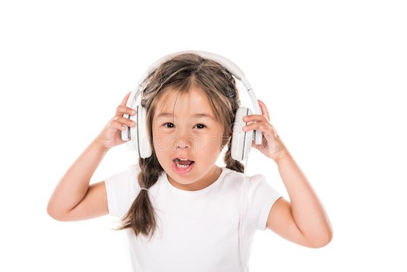 música de escuta da criança fotografia de stock