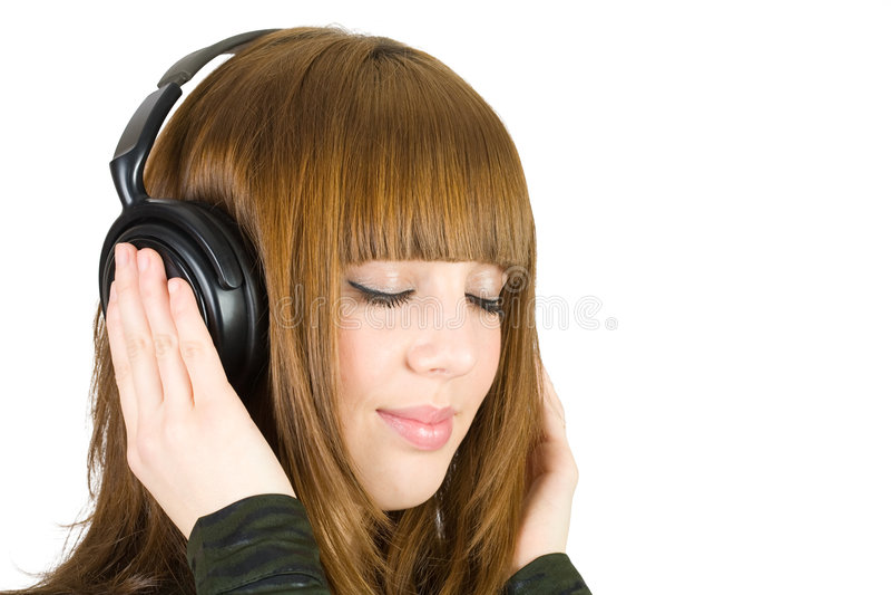 Música de escuta da menina imagem de stock