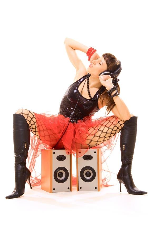 Música de escuta da mulher 'sexy' fotografia de stock royalty free