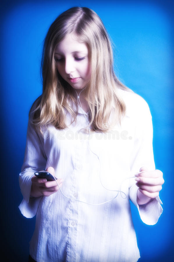 Música de escuta do adolescente fotografia de stock royalty free
