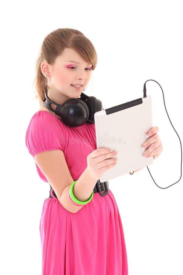 Música de escuta do adolescente atrativo com PC da tabuleta foto de stock