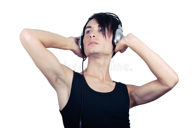 Música de escuta do homem novo imagens de stock