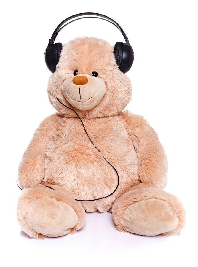 Música de escuta do urso da peluche fotografia de stock royalty free