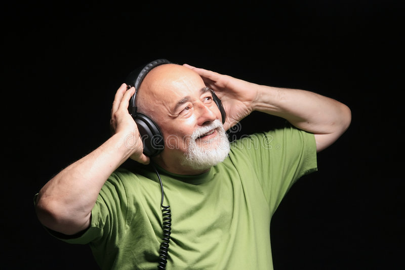 Música e sorriso de escuta fotografia de stock royalty free