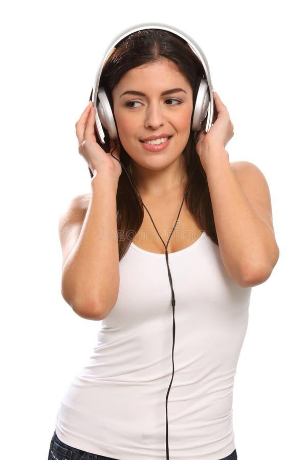Música En Los Oídos De Los Auriculares Que Desgastan De La Chica Joven Imagen de archivo