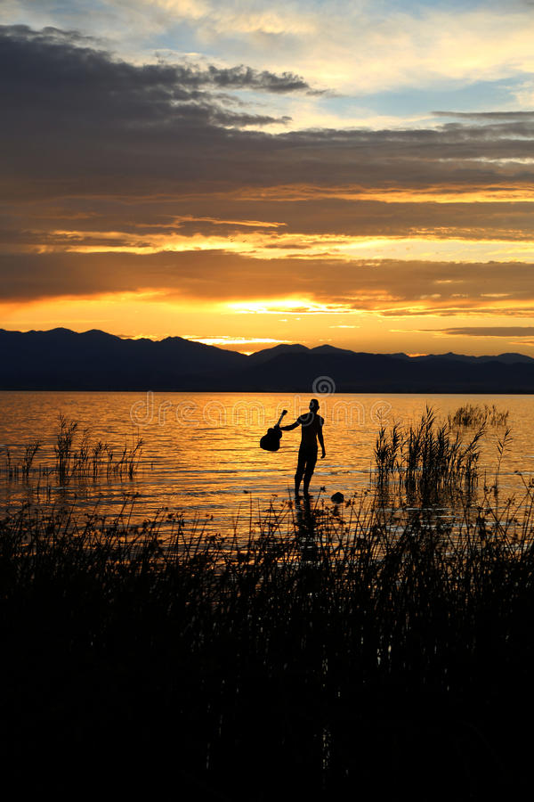 Música pelo por do sol 3 fotografia de stock royalty free