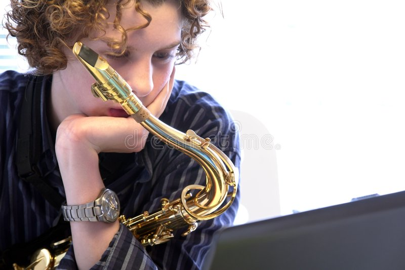 Músico adolescente imagens de stock