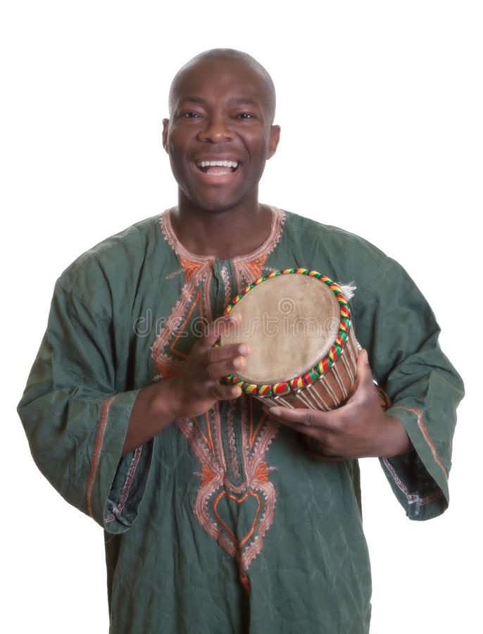 Músico africano com roupa e os cilindros tradicionais fotos de stock royalty free