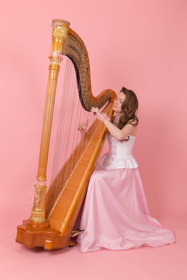 Músico com harpa imagem de stock royalty free