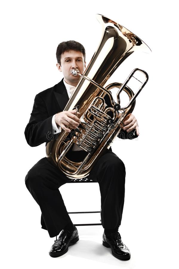 Músico de bronze do jogador da tuba isolado fotos de stock