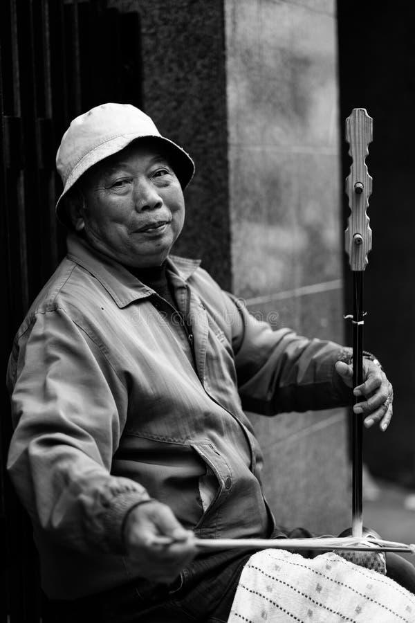 Músico de Chinatown imágenes de archivo libres de regalías